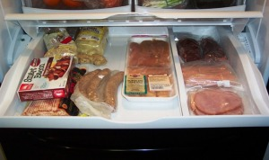 The Meaty Deli Drawer: fake bacon, real bacon, bratwurst, chicken tenders, sirloin steaks, hot dogs, ham, and some other stuff I don't remember putting in there.  I think there may be some gingerroot in the back.